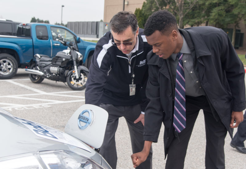 Employee looks at Nissan LEAF