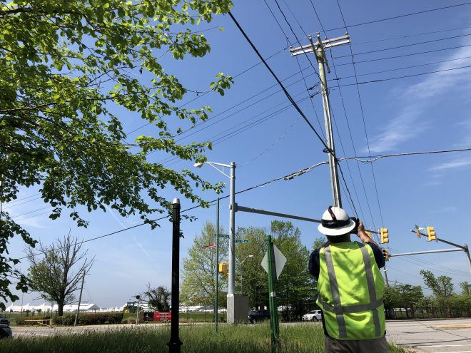 BGE customer reliability support employee inspecting overhead electric equipment