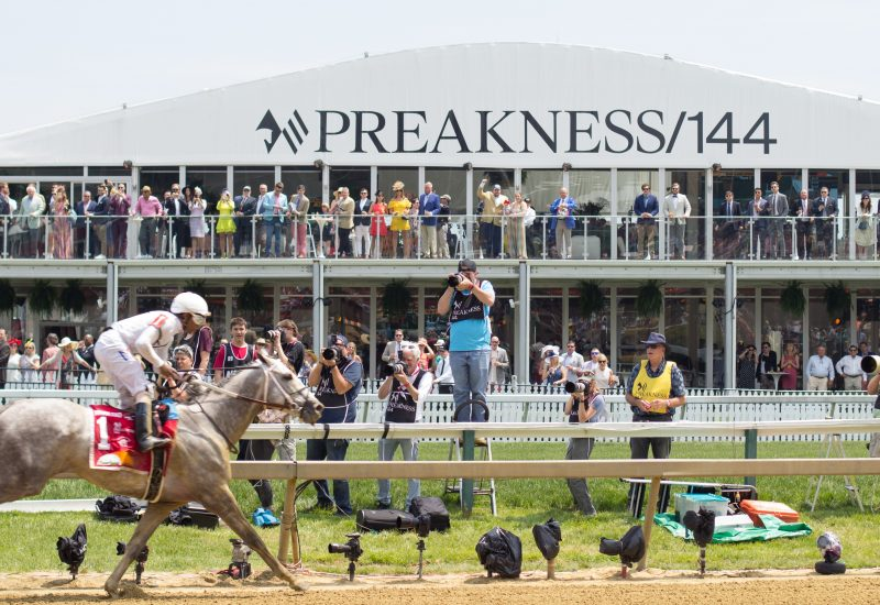 New York Central gallops past the Pimlico infield pavilion after winning the Maryland Sprint Stakes on May 18, 2019.