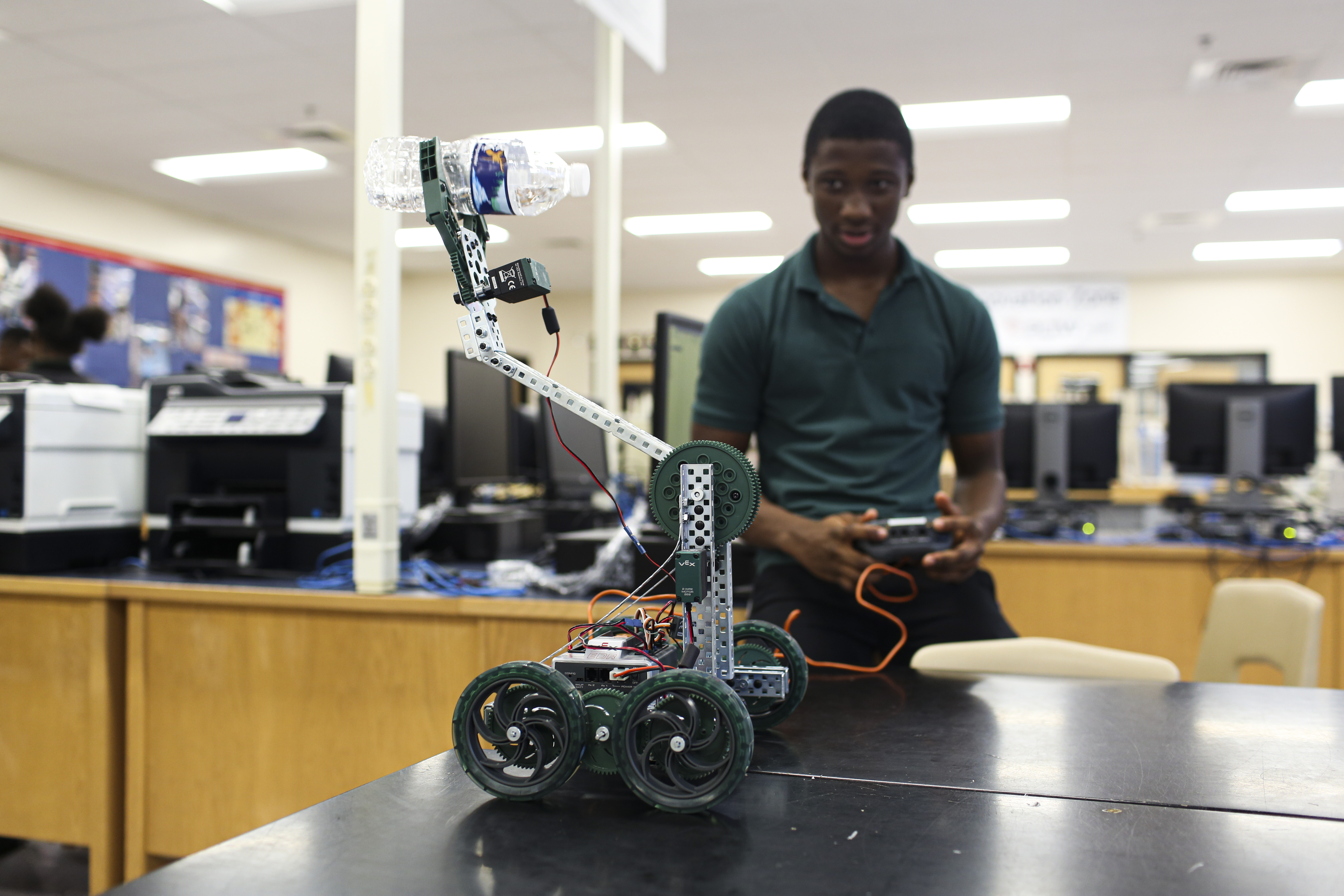 Student shows off his robot.