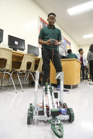Student shows off his robot