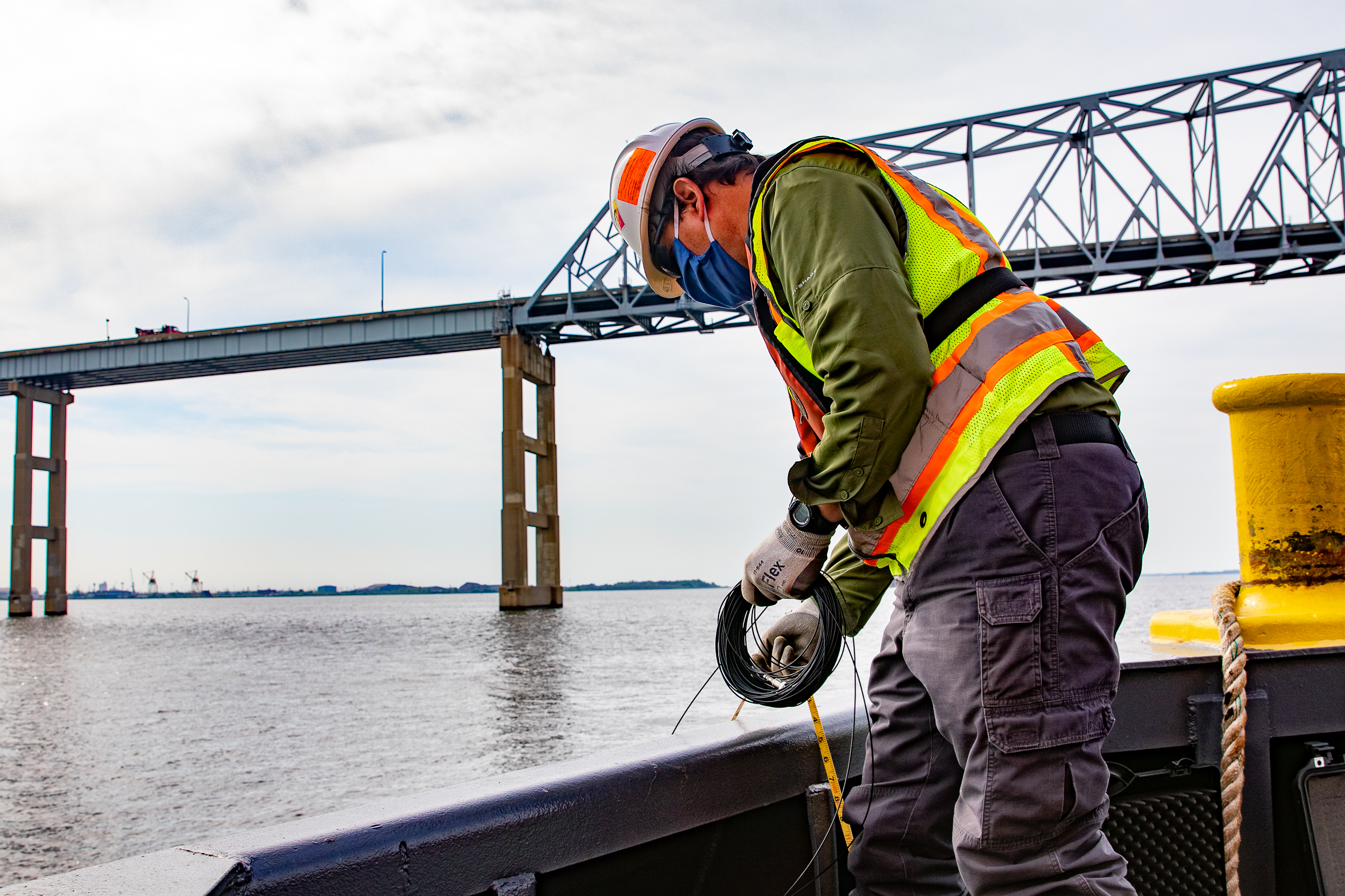 Environmental consultant performs underwater sound monitoring at the Key Crossing construction site