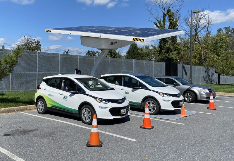Solar ARC chargers charging two Chevy Bolts