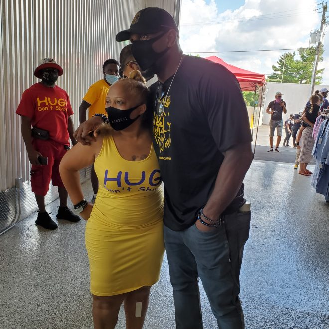 Val Jenkins gets help from Ray Lewis at a recent Hug Don't Shoot event in Baltimore