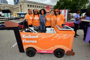Radiant Flames members Taylor and Tawashae pose with Yara Shahidi (center) and fellow team members Therese, Athena, and Morgan in front of their winning Icebox Derby car. Yara, a star of the sitcom Black-ish on ABC®, served as the emcee of the 2016 Icebox Derby race.