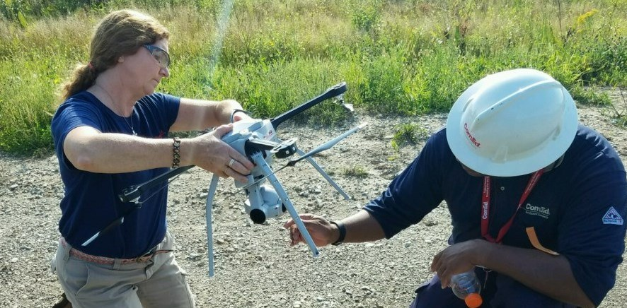 Dara Randerson (left) readies a Skyranger Drone with colleague Maurice Nutall.