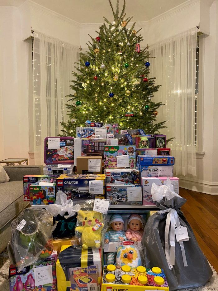 Donated toys under a Christmas tree