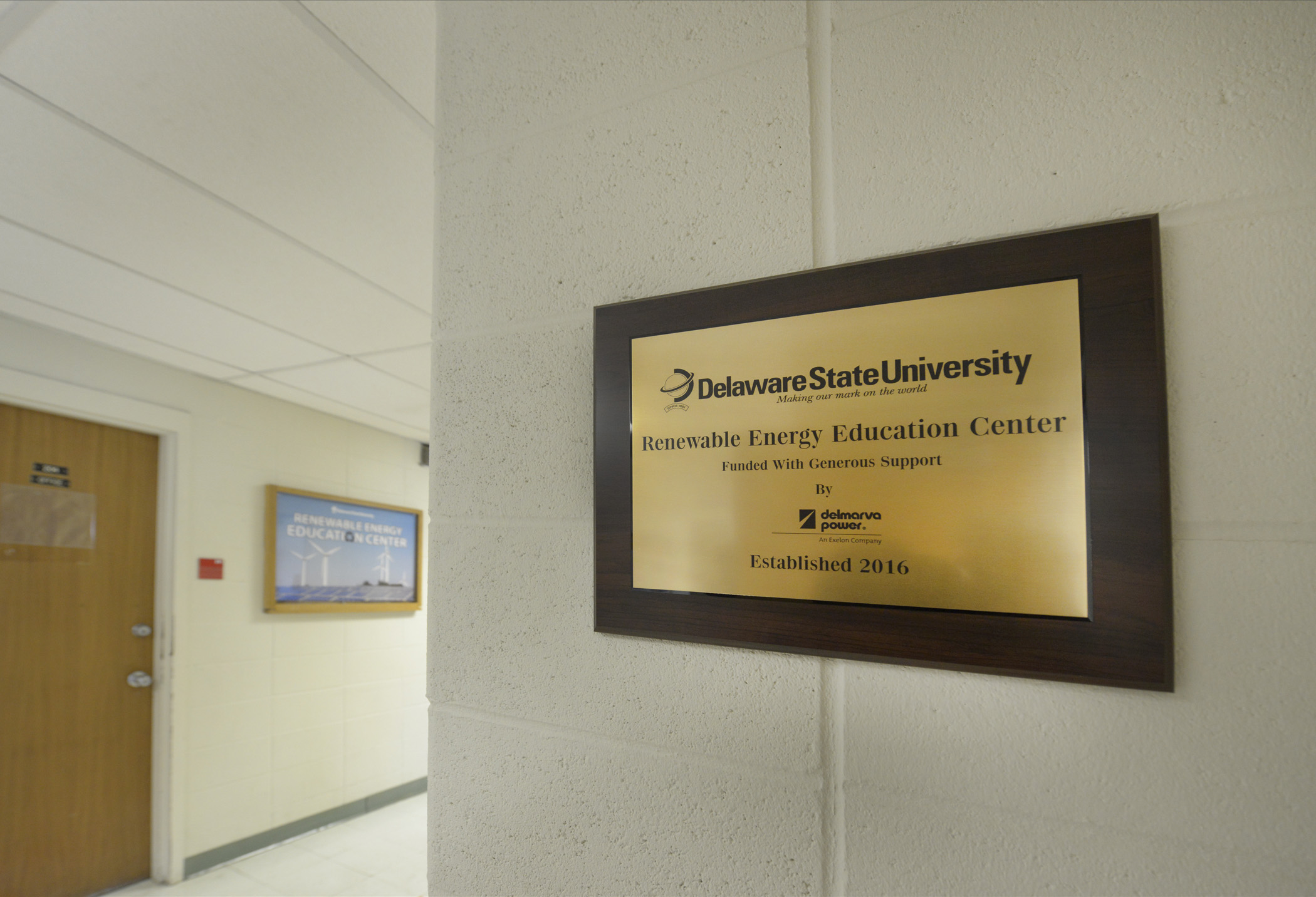 Plaque recognizing Delmarva Power's support of Delaware State University hangs on wall of the Renewable Energy Education Center