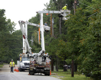 lineworkers fixing wires