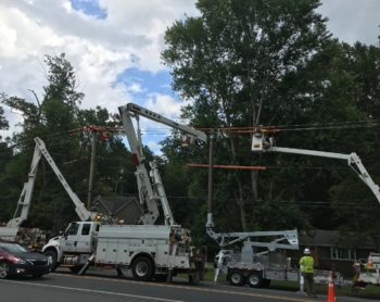 lineworkers fixing wire