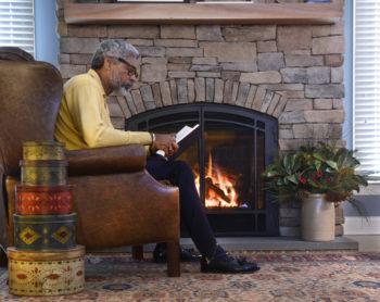 Man sitting at fireplace