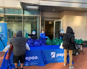 Winter coats and personal care packages are distributed to Washingtonians in need by Pepco volunteers outside of the Pepco Edison Place Gallery